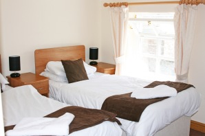 twin beds in the Gremlin Lodge