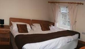 double bed at gremlin lodge web